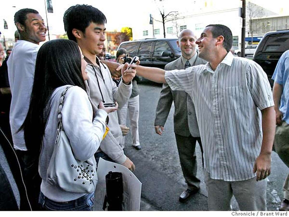 reign082.JPG Actor Adam Sandler made a point of greeting the crowd which had assembled outside the theatre. The new film