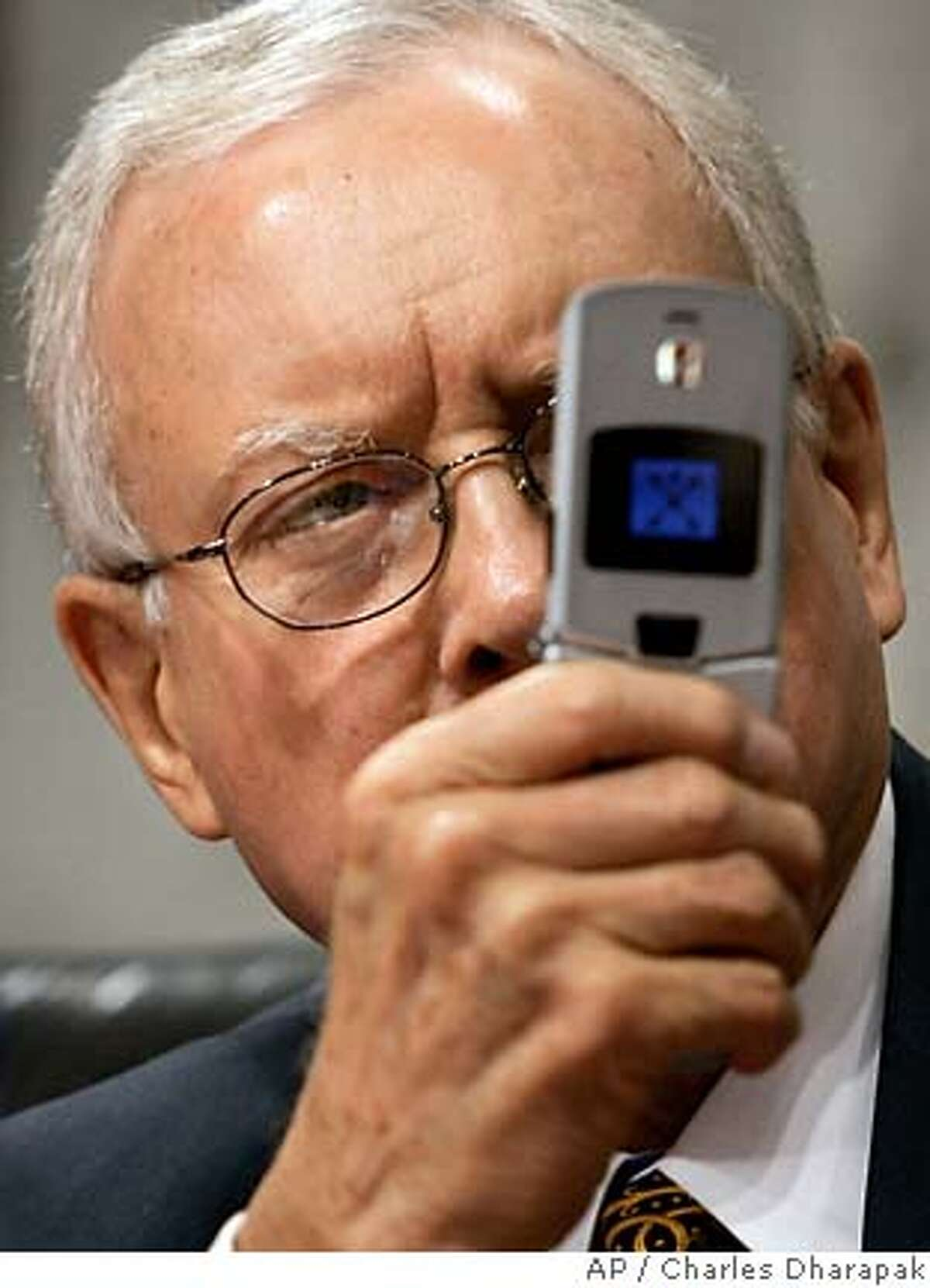 Senate Judiciary Committee member, Sen. Orrin Hatch, R-Utah, uses a cellphone camera as Chief Justice nominee John testifies at his confirmation hearing before the committee on Capitol Hill Thursday, Sept. 15, 2005. (AP Photo/Charles Dharapak)