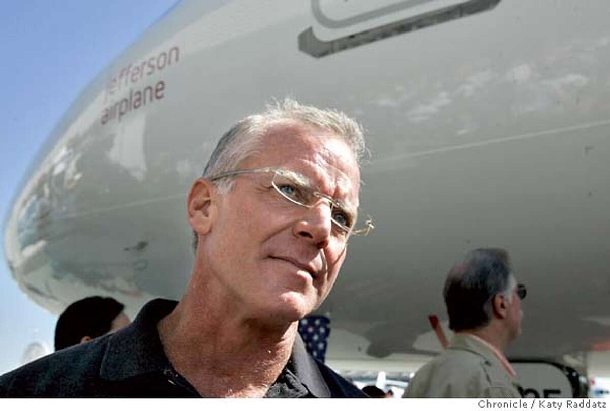"""VIRGIN12_018_RAD.jpg SHOWN: Fred Reid, the CEO of Virgin America, pauses during the festivities of the unveiling with the big plane in the background. The would-be, San Francisco-based airline, Virgin America, takes possession of its first airline, called """"Jefferson Airplane"""" in honor of Grace Slick and the Jefferson Airplane. These photos were made on Wednesday, Oct. 11, 2006, at SFO, CA. (Katy Raddatz/The S.F.Chronicle) **Fred Reid, Grace Slick Ran on: 12-23-2006 The first aircraft of the Virgin America fleet awaits unveiling at SFO in October. Despite delays, the airline hopes to get off the ground in 2007. Ran on: 12-28-2006 Grace Slick presides over the unveiling of a Virgin America jet named after her band Jefferson Airplane in October at SFO. Mandatory credit for photographer and the San Francisco Chronicle/No sales-Mags out"""