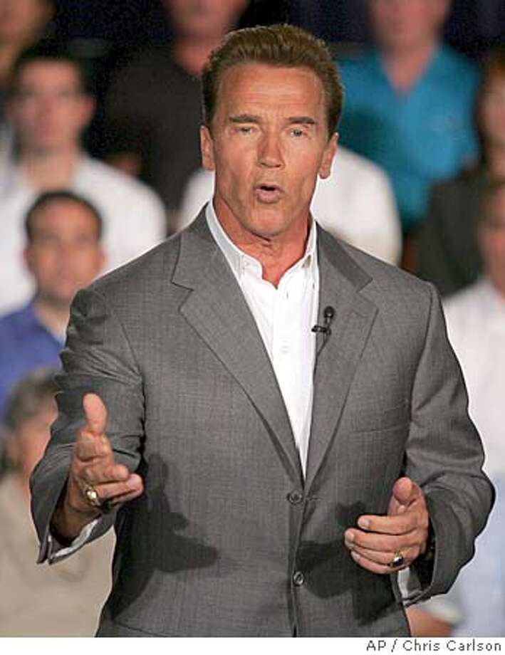 Califronia Governor Arnold Schwarzenegger speaks during his third statewide series of �Conversations with Californians,� a town hall-style meeting Friday, Sept. 16, 2005, in Anaheim, Calif. (AP Photo/Chris Carlson) Photo: CHRIS CARLSON