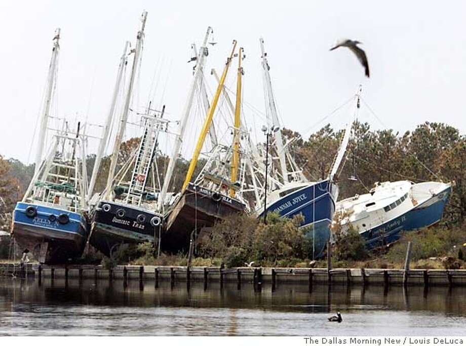 Boats sit washed up on the shore from Hurricane Katrina's storm surge in Bayou La Batre, Ala., Thursday, Sept. 1, 2005. (AP Photo/The Dallas Morning News, Louis DeLuca) Ran on: 09-16-2005  Hurricane Katrina tossed boats on the shore like toys in Bayou La Batre, Ala., devastating the town's key shrimping industry. Ran on: 09-16-2005  Hurricane Katrina tossed boats on the shore like toys in Bayou La Batre, Ala., devastating the town's key shrimping industry. Photo: LOUIS DELUCA