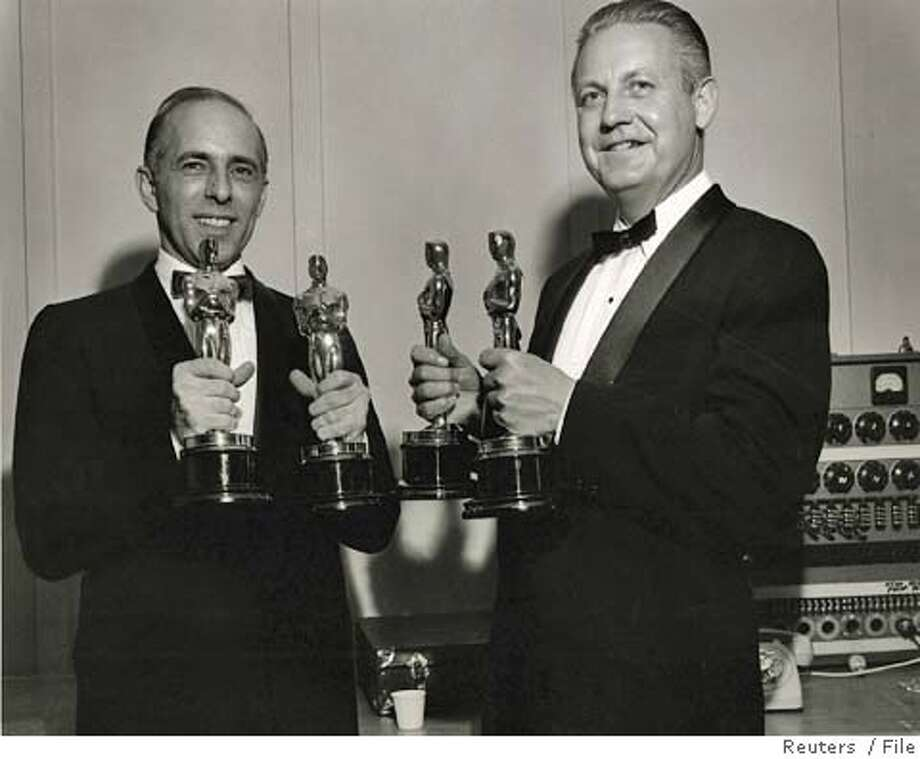 """Four-time Oscar-winning filmmaker Robert Wise (R) and Jerome Robbins pose with the Awards they won for """"West Side Story"""" in 1961 at the 34th Academy Awards. Wise and Robbins shared the Directing Award and also won the Best Picture Oscar. Robbins also received an Honorary Oscar for his cinematography in the film. Wise, who edited the classic �Citizen Kane� for Orson Welles and then went on to direct two of Hollywood's most beloved musicals, �West Side Story� and �The Sound of Music,� has died at age 91, friends said Thursday. FOR EDITORIAL USE ONLY REUTERS/Copyright AMPAS/Handout 0 Photo: HO"""
