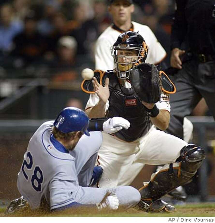 The Los Angeles Dodgers' Jayson Werth, left, scores on a bases-loaded 2-RBI single by Willy Aybar as San Francisco Giants' catcher Mike Matheny takes a late throw, Thursday, Sept. 15, 2005,l in San Francisco. Giants pitcher Brad Hennessey backs up the play. AP Photo/Dino Vournas) Photo: DINO VOURNAS