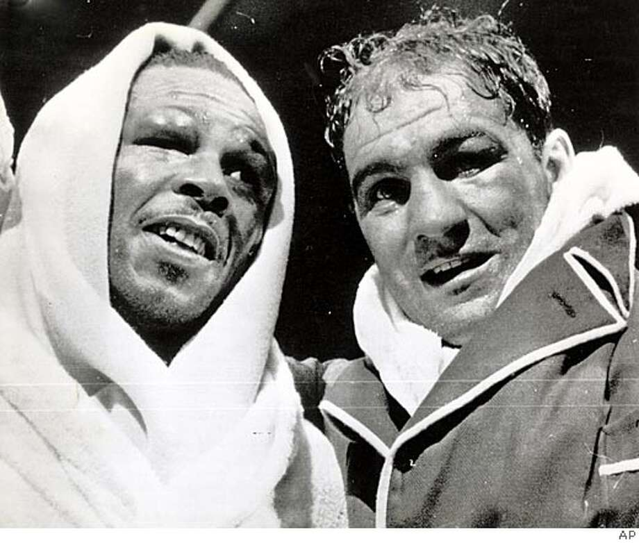 Rocky Marciano (right) defended his title against Archie Moore. Associated Press File Photo, 1955