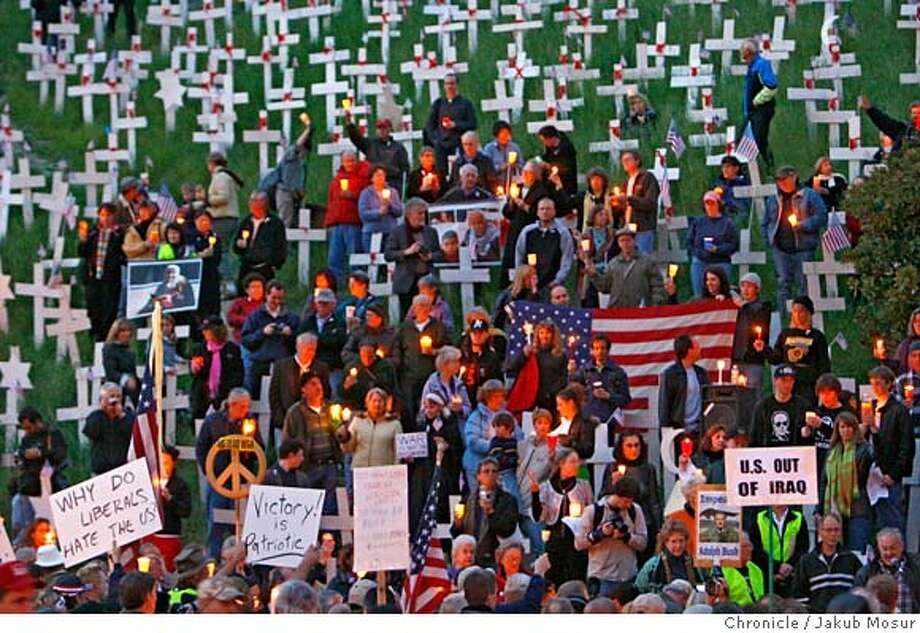 Protest_06_JMM.JPG Pro-Iraq war protesters stand in opposition to supporters of the Crosses at Lafayette gather for a candle light vigil to mark the 4th anniversary of the ongoing war in Iraq. Event on 3/19/07 in Lafayette. JAKUB MOSUR / The Chronicle Photo: JAKUB MOSUR