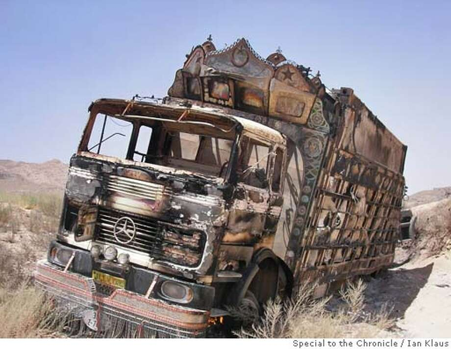 Just outside the village of El Bak, a burned-out Jingle truck--some of its decorations still visible--after Taliban attack. The drivers escaped with injuries. By Ian Klaus/Special to The Chronicle Ran on: 09-16-2005  A burned-out &quo;jingle&quo; truck sits near El Bak after a Taliban attack. The drivers escaped with injuries. Photo: Ian Klaus/Special To The Chronic