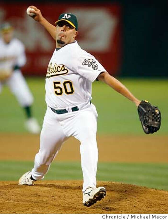 athletics_406_mac.jpg A's pitcher -Kiko Calero closes out the 9th inning. Oakland Athletics vs. Seattle Mariners Event in, Oakland, Ca, on 8/15/06. Photo by: Michael Macor / San Francisco Chronicle Mandatory credit for Photographer and San Francisco Chronicle No sales/ Magazines Out Photo: Michael Macor
