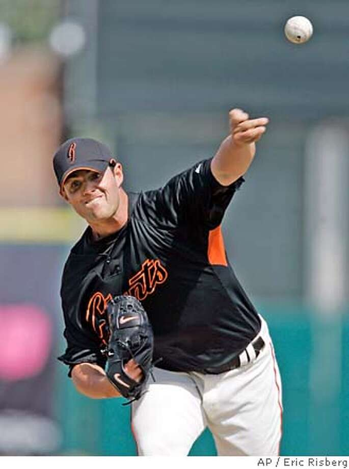 San Francisco Giants' starting pitcher Noah Lowry throws a warm up pitch in the first inning of their spring training baseball game against the Seattle Mariners in Scottsdale, Ariz., Sunday, March 4, 2007. (AP Photo/Eric Risberg) Photo: Eric Risberg