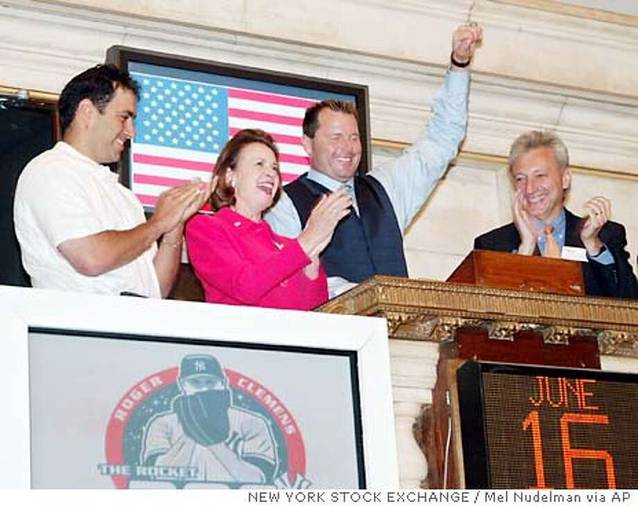 **CORRECTS AFFILIATION OF KEN JOWDY** New York Yankees pitcher Roger Clemens, center, gestures after ringing the opening bell at the New York Stock Exchange in celebration of this 300th win Monday, June 16, 2003. Standing from left are Ken Jowdy, a personal friend or Roger Clemens; Catherine Kinney, chief operations officer at the NYSE; Clemens and Robert Zito, Executive Vice-President of Communications at the NYSE. (AP Photo/Mel Nudelman) Photo: MEL NUDELMAN