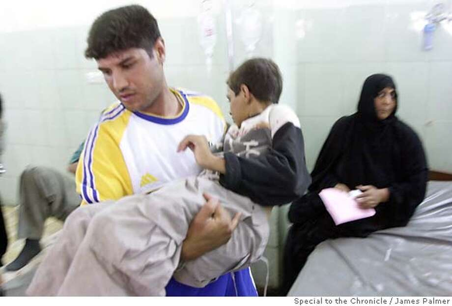An Iraqi boy awaits medical treatment in the emergency room at Yarmouk Hospital in Baghdad, Iraq, on September 28, 2006. Psychiatrists here are warning of a disturbing spike in mental health disorders among Iraq�s population, particularly children, as terrorism, an armed insurrection, and a bloody sectarian divide has gained a stranglehold on the country and its people. The escalating psychiatric caseloads are compounded by Iraq�s lack of mental health workers, facilities, and services leaving many people throughout the country with little or no treatment. The striking imbalance between the ongoing violence in Iraq and deficiencies in its mental health care system has triggered alarm among Iraq�s psychiatrists who said the consequences may permanently damage generations of this distressed nation. James Palmer / Special to The Chronicle Ran on: 03-19-2007  An Iraqi boy awaits treatment in the emergency room at Yarmouk Hospital in Baghdad. A study of 10,000 primary school students found at least 70 percent suffered from trauma-related symptoms.  Ran on: 03-19-2007  An Iraqi boy awaits treatment in the emergency room at Yarmouk Hospital in Baghdad. A study of 10,000 primary school students found at least 70 percent suffered from trauma-related symptoms. Photo: James Palmer