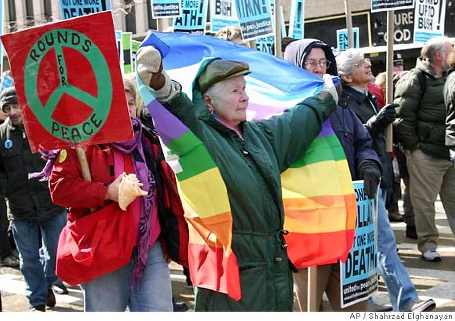 """Demonstrators partake in an anti-war protest in New York on Sunday March 18, 2007. Hundreds of anti-war activists, calling for the """"defunding"""" of the war in Iraq or the immediate return of U.S. troops, marched through Manhattan on Sunday and took their case to the offices of the state's two Democratic senators. (AP Photo/Shahrzad Elghanayan) Photo: SHAHRZAD ELGHANAYAN"""