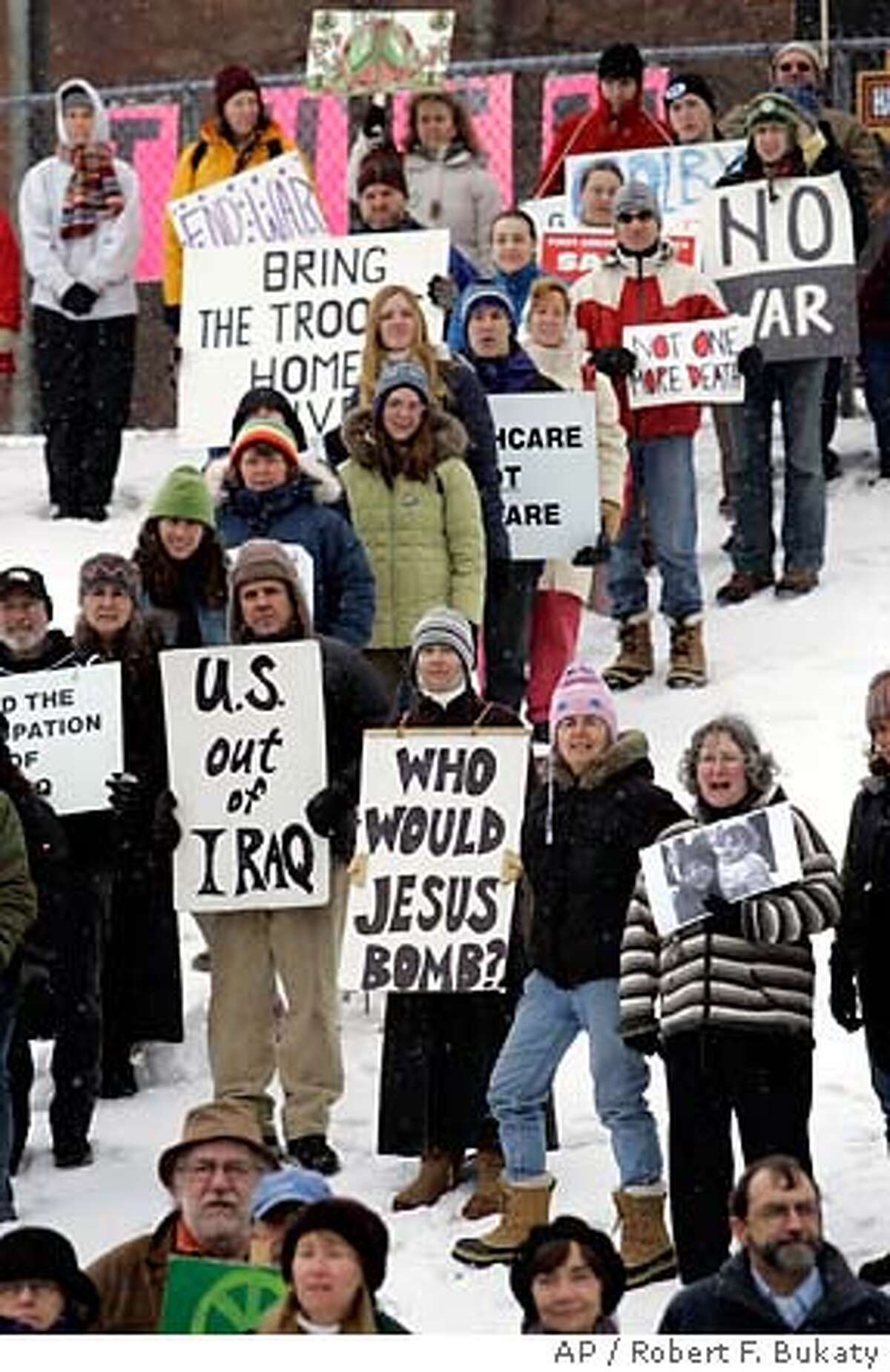 Demonstrators hold signs and sing during a protest against the Iraq war, Sunday, March 18, 2007, in Bangor, Maine. Antiwar activists gathered in dozen of towns and cities across Maine on Sunday in a storm-delayed show of opposition to the Iraq war timed to coincide with its fourth anniversary. The events came on the heels of Saturday's march on the Pentagon that drew thousands of demonstrators, including about 120 from Maine. (AP Photo/Robert F. Bukaty)