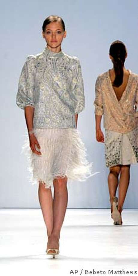 An ice metallic metelasse top is modeled over an ostrich feather skirt during the presentation of the spring 2006 collection of Peter Som in New York, Wednesday Sept. 14, 2005. (AP Photo/Bebeto Matthews) Photo: BEBETO MATTHEWS