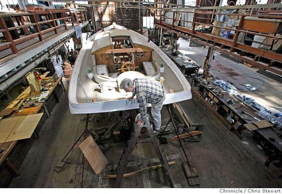 boat_227_cs.jpg  Bob Darr, 55, program director and head instructor of the Arques School of Traditional Boatbuilding, climbs aboard the Freda as he oversees restoration work on the 19th century yacht at the non-profit Spaulding Wooden Boat Center in Sausalito. Built in 1885, the Freda is thought to be the oldest sailing yacht on the West Coast. With a 32-foot deck and an overall length of 52 feet, the Freda is slowly being taken apart and rebuilt at the Spaulding warehouse. Chris Stewart / The Chronicle Bob Darr, Spaulding Wooden Boat Center, Freda MANDATORY CREDIT FOR PHOTOG AND SF CHRONICLE/NO SALES-MAGS OUT Photo: Chris Stewart