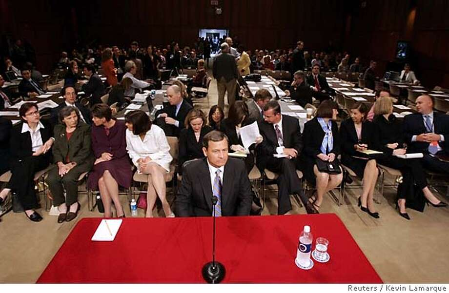 Supreme Court Chief Justice nominee John Roberts waits for the start of his third day of confirmation hearings on Capitol Hill in Washington, September 14, 2005. During yesterday's session, Roberts declined to say if he would reverse the long-standing decision legalizing abortion but said he believed the Constitution accorded Americans the right to privacy, the key underpinning of the landmark ruling. REUTERS/Kevin Lamarque Photo: KEVIN LAMARQUE