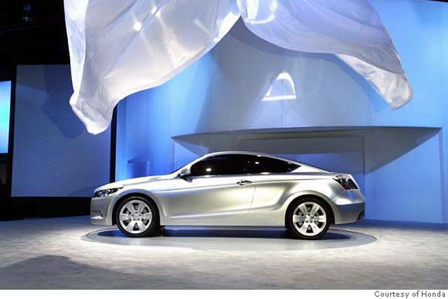 DETROIT, Jan. 8, 2007 � Honda unveiled the Accord Coupe Concept today at the 2007 North American International Auto Show in Detroit. The Honda Accord Coupe Concept reveals a totally new look for the next-generation Accord, along with key technologies for safety, fuel efficiency and performance. The Accord is Honda's best-selling model in North America and its debut at NAIAS marks the first time that an Accord concept vehicle has ever been shown at a major auto show. The styling of the Accord Coupe Concept conveys a powerful stance through its long hood, deeply sculpted lower body and fastback roofline. A six-sided grille and projector headlamps that recess deep into the front fenders contribute to an unmistakable and aggressive front fascia. Quad exhaust outlets integrated into the rear diffuser further convey performance and style beyond any Accord to date. For additional information go to www.hondanews.com. Photo: Honda