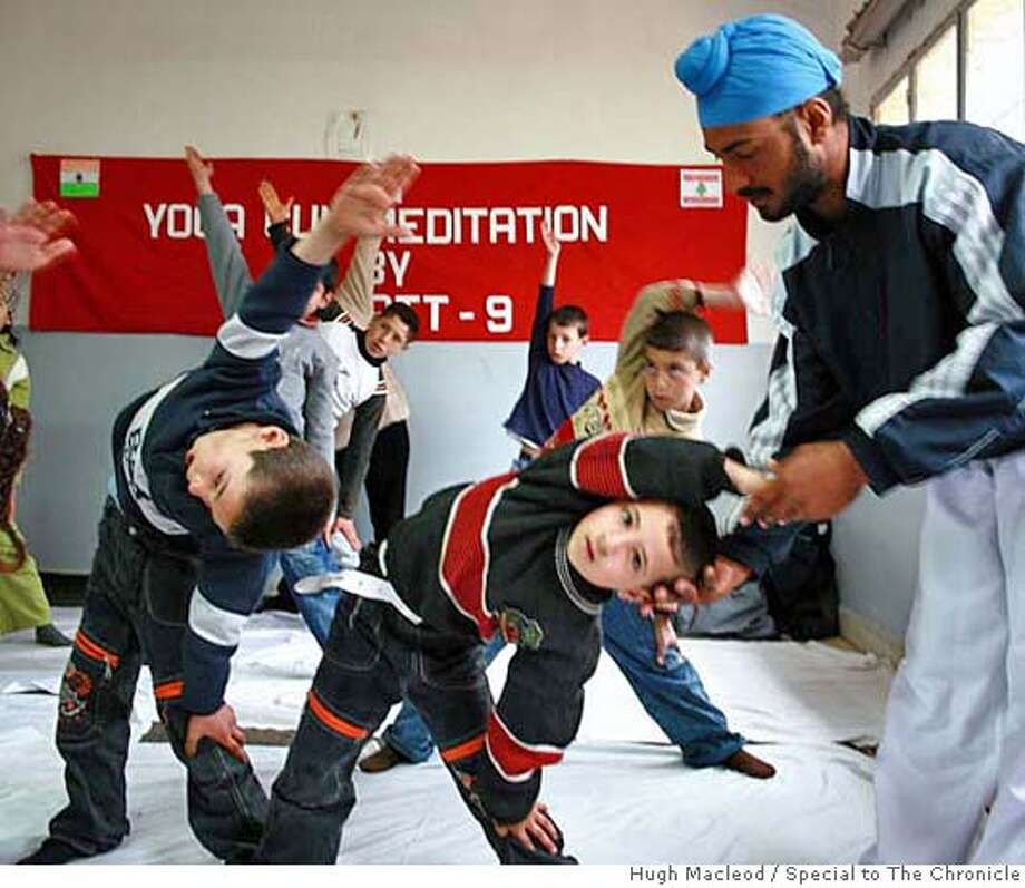 School children enjoy a yoga class with members of UNIFIL�s Indian battalion in Ebl es Saqi, Lebanon. Hugh Macleod/Special to The Chronicle NO MAGS, NO SALES, NO TV Photo: Hugh MacLeod