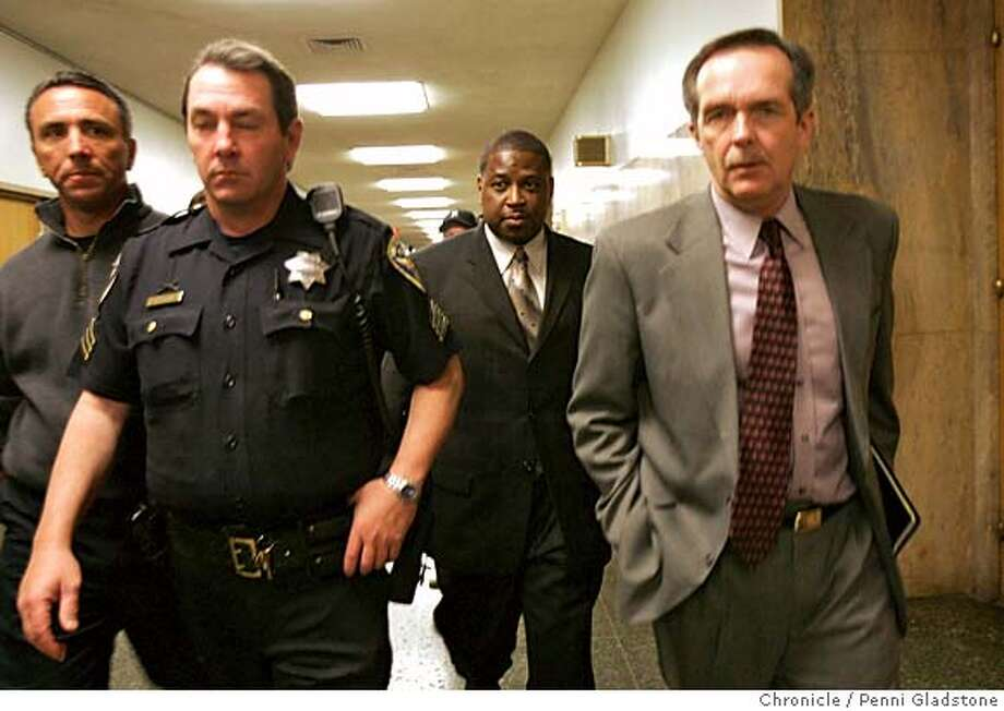 HILL_0063_PG.JPG Barry Parker, at center, was Espinoza's partner who took stand in the morning. Walks out of courtroom at lunch.  Preliminary hearing scheduled for David Hill, the defendant in the April 2004 killing of SFPD Officer Isaac Espinoza at Hall of Justice.  San Francisco Chronicle, Penni Gladstone  Photo taken on 9/12/05, in San Francisco, Photo: Penni Gladstone