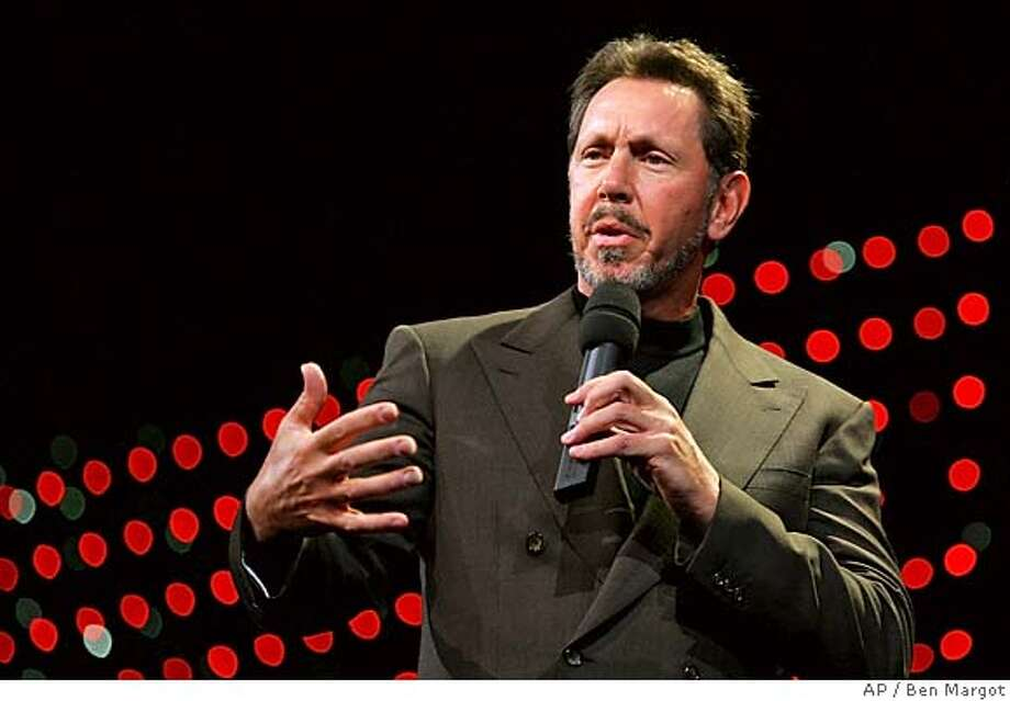 ** FILE ** In a file photo Oracle chief executive Larry Ellison gestures while delivering the keynote address to Oracle customers Wednesday, Dec. 8, 2004, in San Francisco. The business software company Oracle Corp. on Monday, Sept. 12, 2005, said it will acquire Siebel Systems Inc., which makes software to help companies manage relationships with their customers, in a deal worth about $5.85 billion in cash and stock. (AP Photo/Ben Margot) DEC. 8, 2004, PHOTO Photo: BEN MARGOT