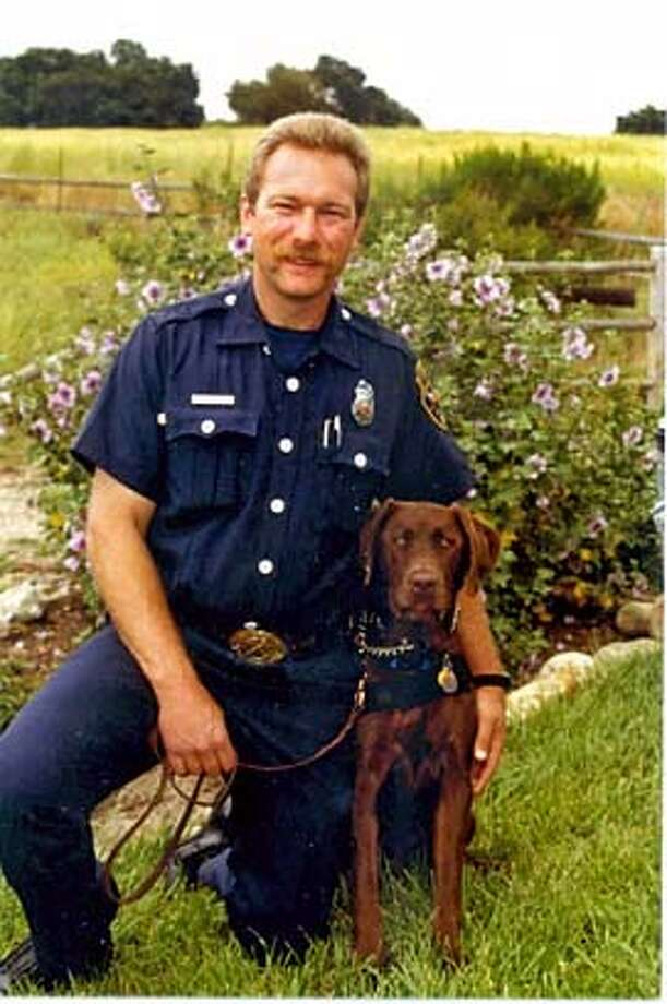 Jeff Place of the Fremont Fire Department and his dog, Zack, were part of a task force that helped Hurricane Katrina victims in Biloxi, Miss. No credit is necessary Photo: X