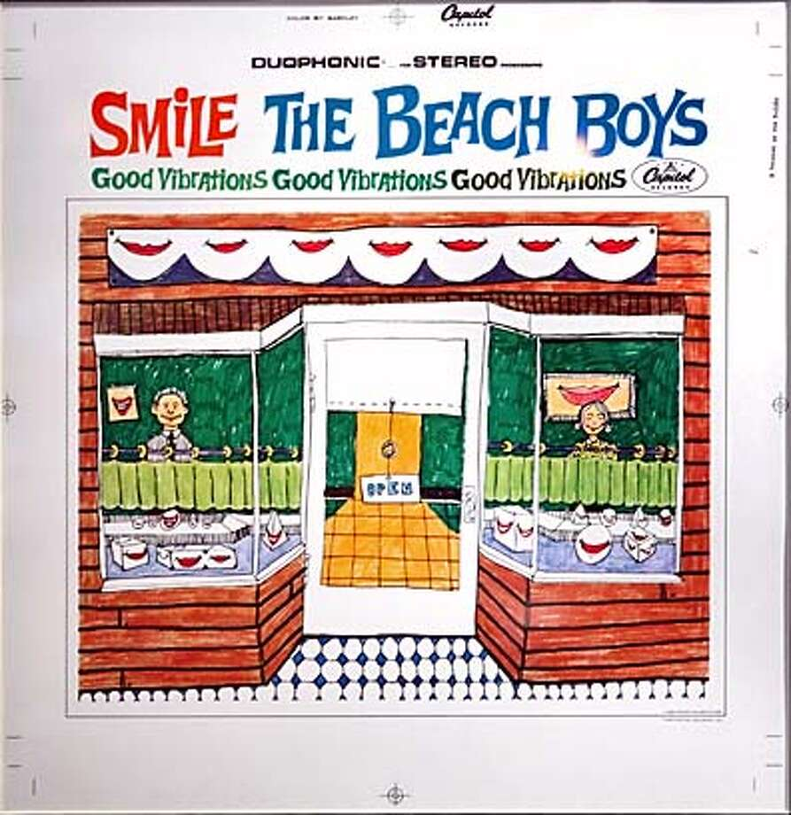 """smile13_ch_047.jpg  Frank Holmes, the artist who drew the cover to the most famous unreleased album in rock -- the Beach Boys' """"Smile."""" Holmes' original artwork is being exhibited on the walls of Enrico's.  in San Francisco  9/8/05 Chris Hardy / San Francisco Chronicle Photo: Chris Hardy"""