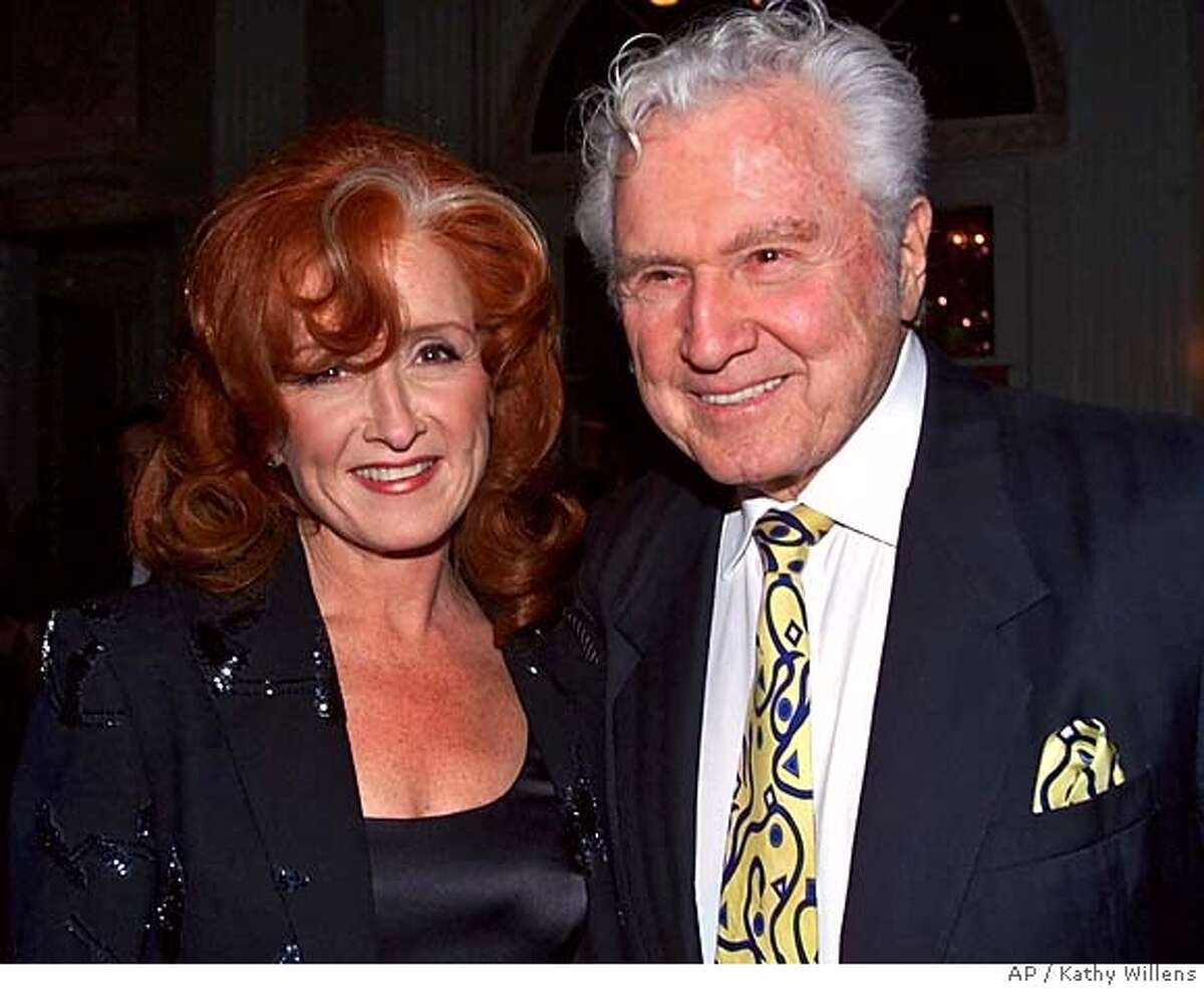 """**FILE** Singer Bonnie Raitt, left, and her father John Raitt pose during a cocktail party before attending the 15th Annual Rock and Roll Hall of Fame Induction Dinner in this Monday, March 6, 2000 file photo, at New York's Waldorf-Astoria hotel. John Raitt, the robust baritone who created the role of Billy Bigelow in the original New York production of """"Carousel"""" and sang with Doris Day in the movie """"Pajama Game,"""" died Sunday. He was 88. (AP Photo/Kathy Willens, FILE) Ran on: 02-21-2005 John Raitt posed with Bonnie before her Rock and Roll Hall of Fame induction dinner at the Waldorf-Astoria Hotel in New York. Ran on: 02-21-2005 John Raitt posed with Bonnie before her Rock and Roll Hall of Fame induction dinner at the Waldorf-Astoria Hotel in New York. Ran on: 02-21-2005 John Raitt posed with Bonnie before her Rock and Roll Hall of Fame induction dinner at the Waldorf-Astoria Hotel in New York. A MARCH 6, 2000 FILE PHOTO"""