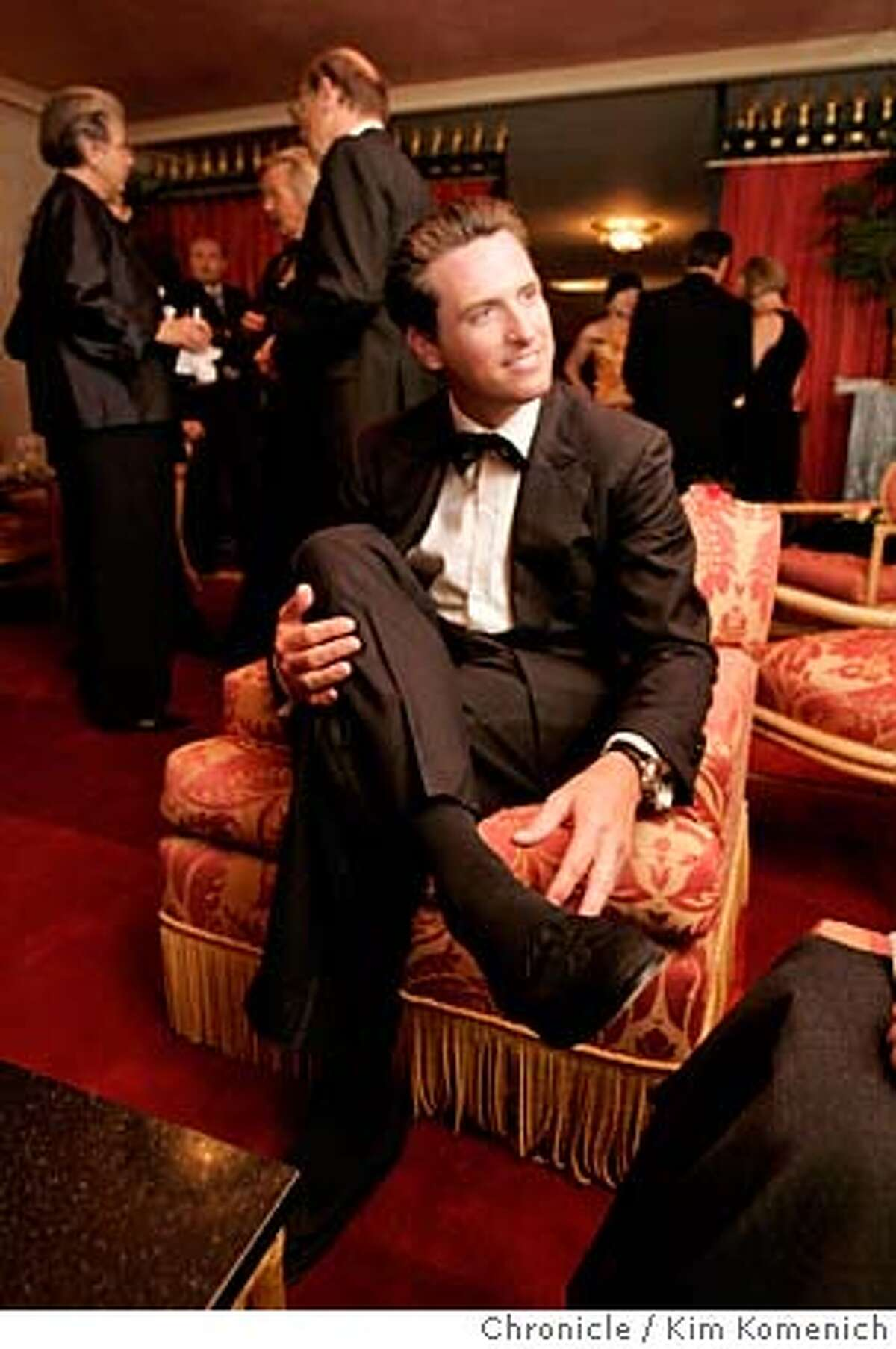 """SFOPERA_STYLE120217_kk.JPG San Francisco Mayor Gavin Newsom shows his Moroccan slippers, a souvenir from a trip to Morrocco when he was in the seventh grade. The San Francisco Opera's 83rd opening night gala. NOTE: This shoot (for Bigelow) was done simultaneously with ROSENBURG12 (for Zinko.) We follow operagoers through the parties before the Opera' s performance of """"Italian Girl in Algiers."""" We also shadow outgoing Opera General Director during the hours before the opening. San Francisco Chronicle Photo by Kim Komenich 9/10/05"""