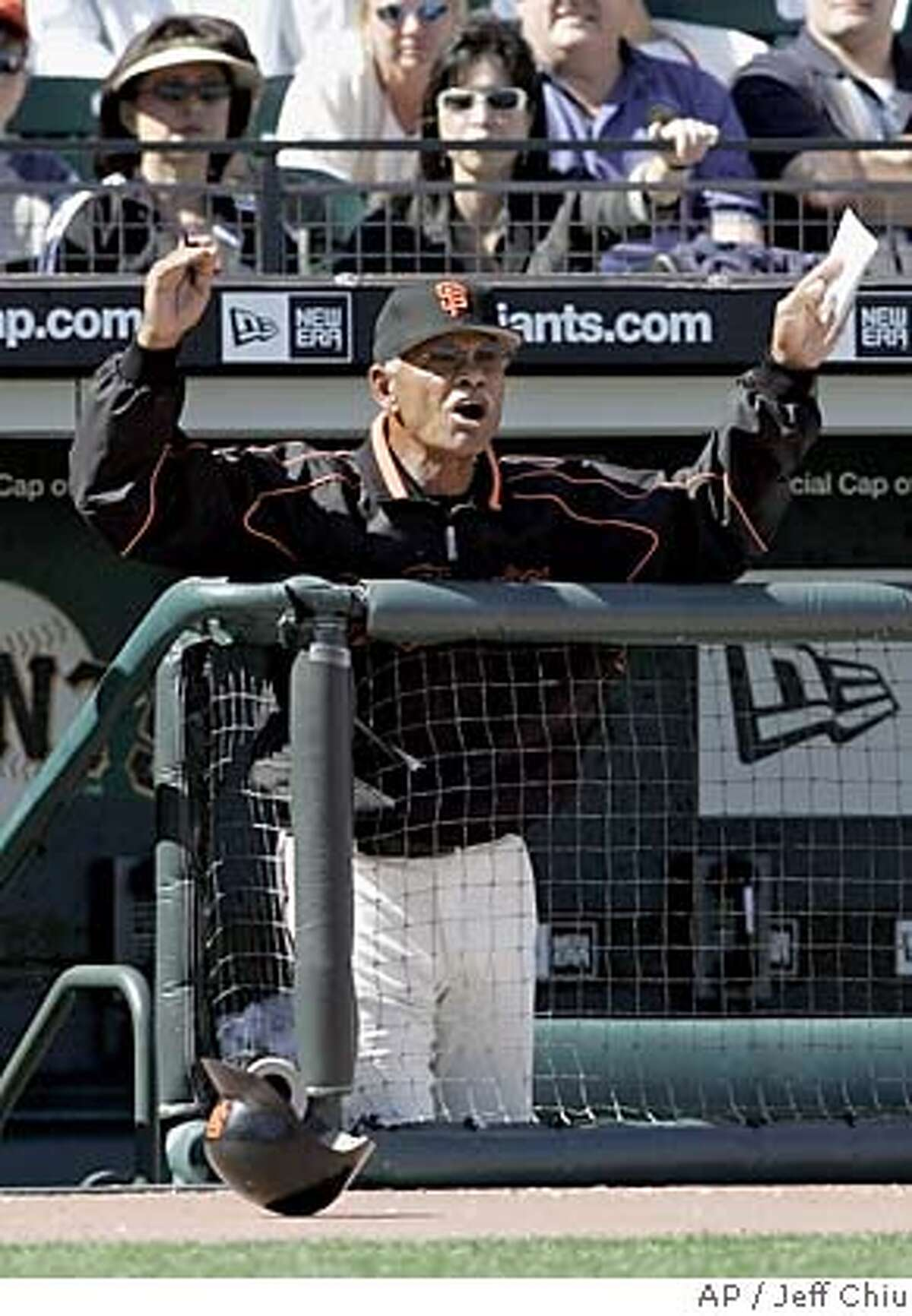 San Francisco Giants manager Felipe Alou yells at umpires after Giants' Lance Niekro struck out to end the eighth inning against the Chicago Cubs in San Francisco on Sunday, Sept. 11, 2005. The Cubs won, 3-2. (AP Photo/Jeff Chiu)
