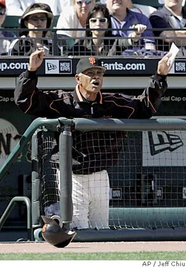 San Francisco Giants manager Felipe Alou yells at umpires after Giants' Lance Niekro struck out to end the eighth inning against the Chicago Cubs in San Francisco on Sunday, Sept. 11, 2005. The Cubs won, 3-2. (AP Photo/Jeff Chiu) Photo: JEFF CHIU