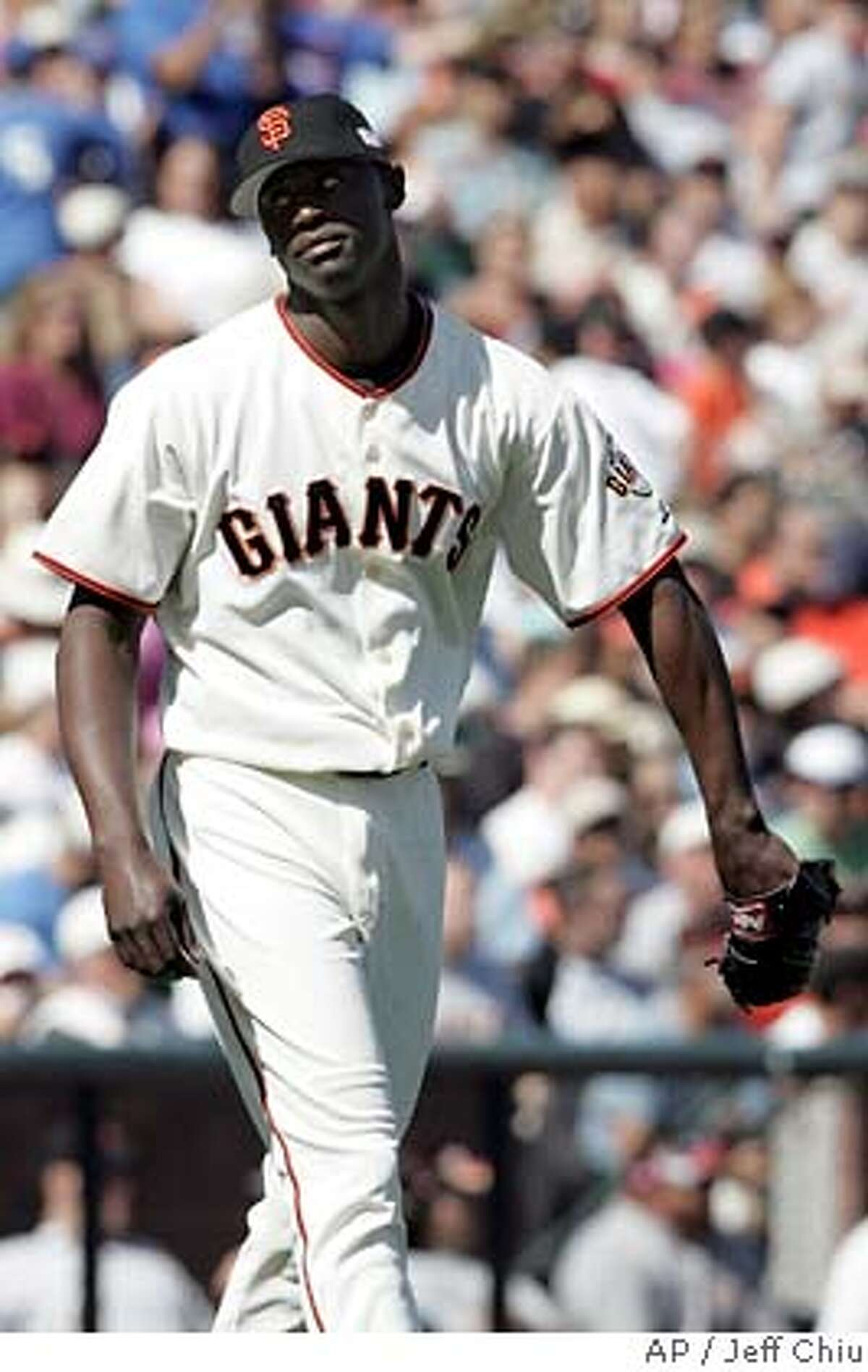 San Francisco Giants' LaTroy Hawkins walks away from the mound after giving up a tiebreaking RBI double to Chicago Cubs' Neifi Perez in the eighth inning in San Francisco on Sunday, Sept. 11, 2005. The Cubs won 3-2. Hawkins was the losing pitcher. (AP Photo/Jeff Chiu)