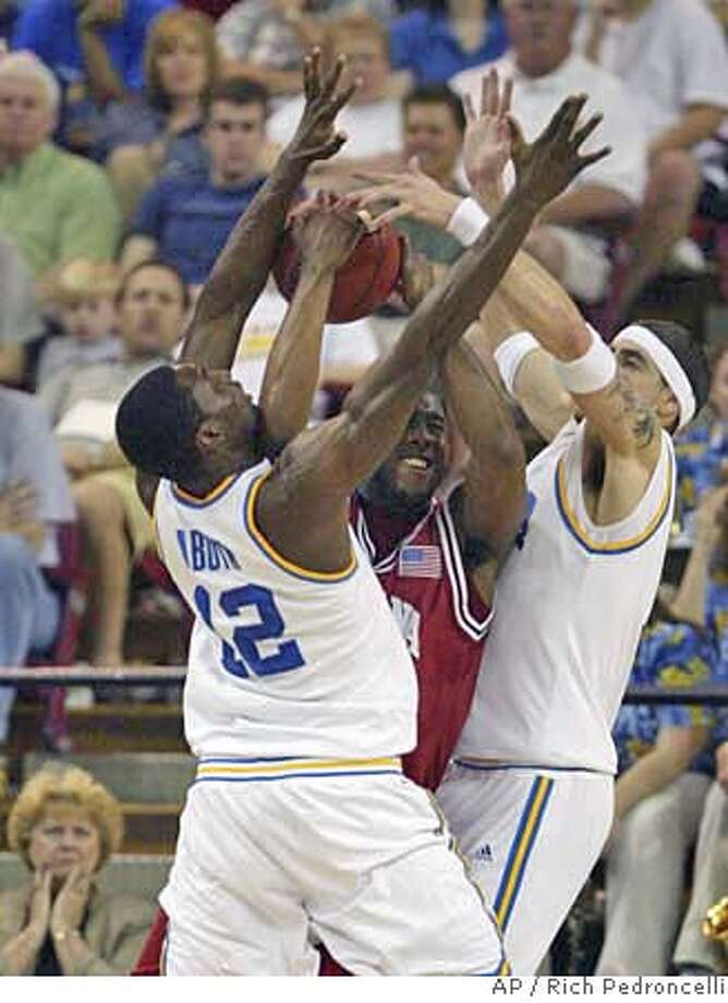 Indiana guard Armon Bassett, middle, tries to pass the ball but is blocked by UCLA forward Alfred Aboya, left, and center Lorenzo Mata, right, during the second round of the NCAA West Regional basketball tournament at Arco Arena in Sacramento, Calif., Saturday, March 17, 2007. (AP Photo/Rich Pedroncelli) Photo: Rich Pedroncelli