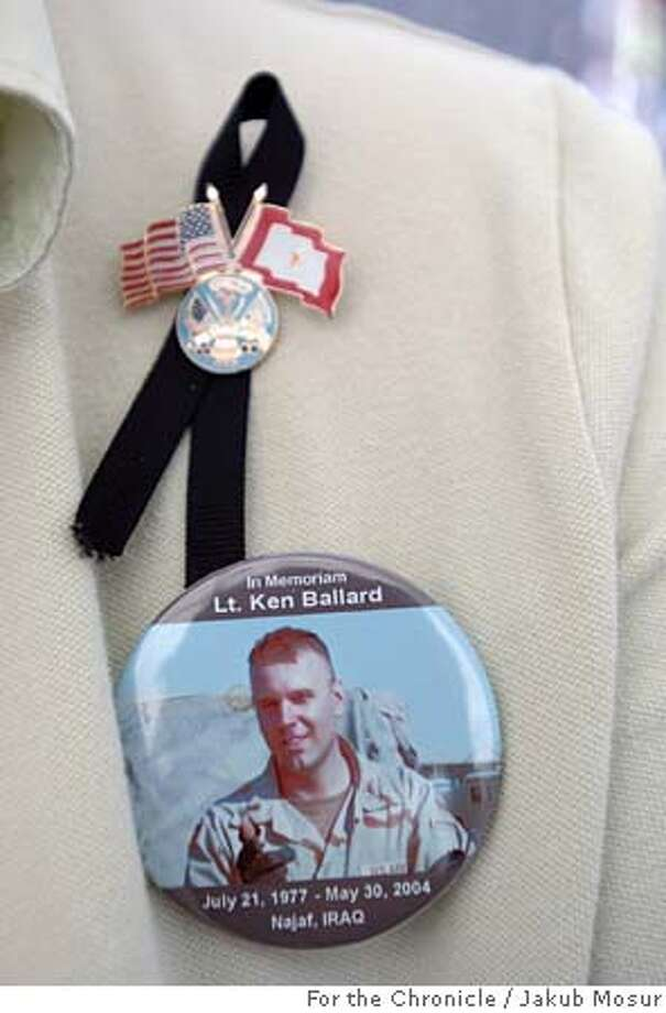 """Mother11_05_JMM.JPG  Karen Meredith of Mountain View wears a button with a picture of her son Lt. Kenneth Ballard, who was killed in Iraq on May 31, 2004. Meredith was working at her """"Bead Sisters"""" booth at the Mountain View Art and Wine Festival on Saturday Sept. 10, 2005. Event on 9/10/05 in Mountain View. JAKUB MOSUR / The Chronicle MANDATORY CREDIT FOR PHOTOG AND SF CHRONICLE/ -MAGS OUT Photo: JAKUB MOSUR"""