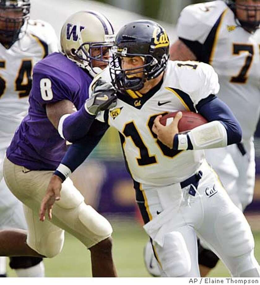 California quarterback Joe Ayoob (18) is finally caught by Washington's Dason Goldson (8) on a keeper play in the second quarter Saturday, Sept. 10, 2005, in Seattle. Ayoob ran for 26 yards and a first down on the play. (AP Photo/Elaine Thompson) Photo: ELAINE THOMPSON