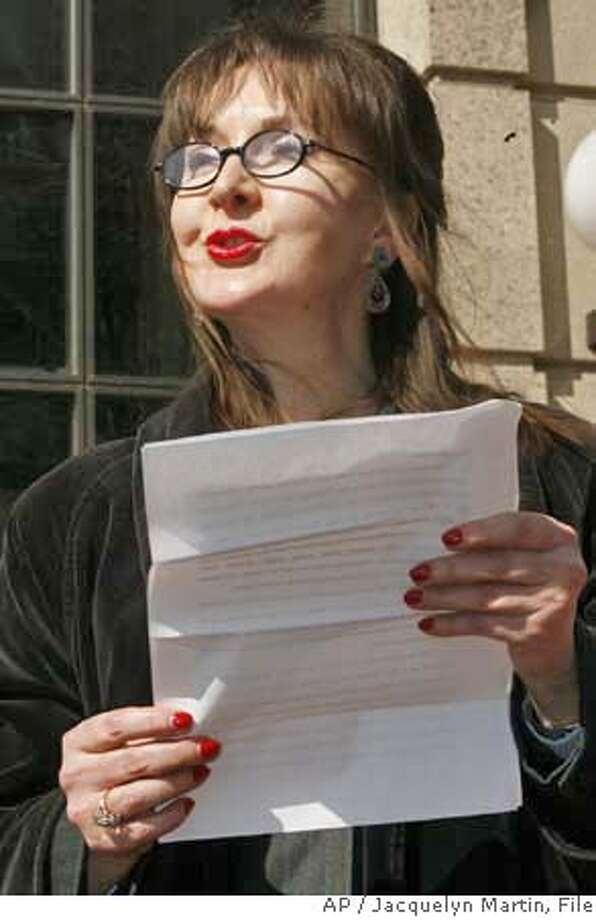 Deborah Palfrey of Vallejo, Calif., reads a statement outside federal court in Washington, Friday, March 9, 2007, after her arraignment on federal racketeering charges. (AP Photo/Jacquelyn Martin)  Ran on: 03-10-2007  Deborah Jeane Palfrey reads a statement in Washington, D.C., denying wrongdoing.  Ran on: 03-10-2007 Photo: Jacquelyn Martin