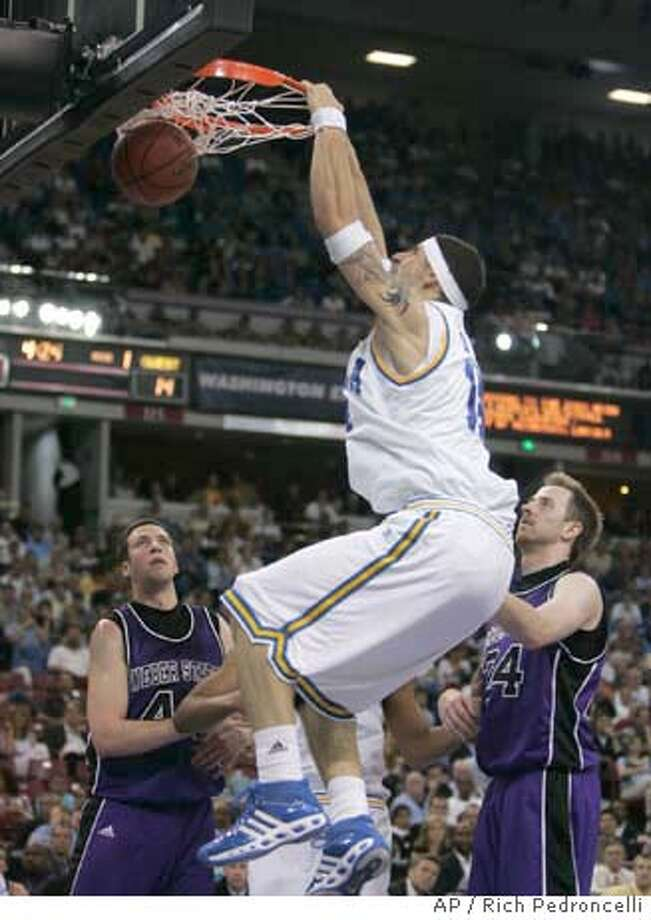 UCLA center Lorenzo Mata dunks the ball through the basket as Weber State forward Tyler Billings, left, and David Patten, right, look on during the first round of the NCAA West Regional basketball tournament at Arco Arena in Sacramento, Calif., Thursday, March 15, 2007. (AP Photo/Rich Pedroncelli ) Photo: Rich Pedroncelli