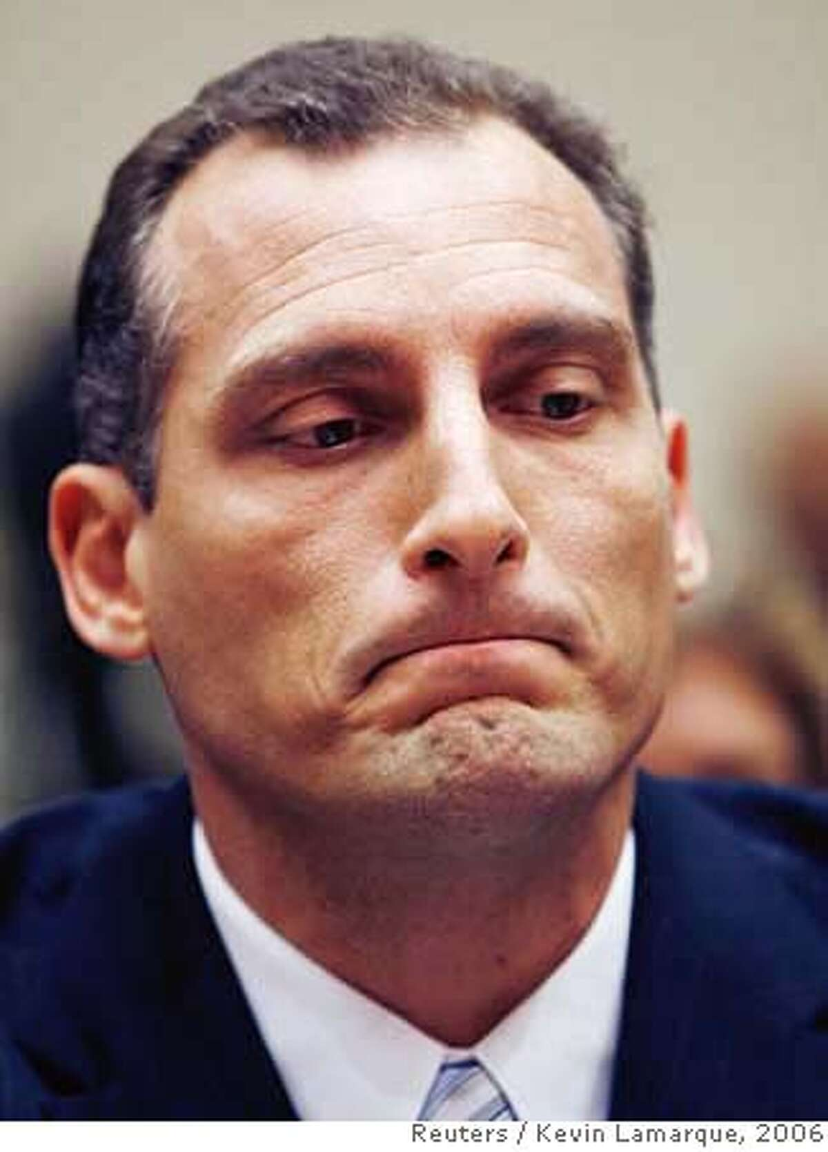 Kevin Hunsaker, senior legal counsel at Hewlett Packard, looks down as he pleads the 5th amendment rather than testify before the U.S. House Energy and Commerce Committee's Hewlett-Packard data privacy hearing on Capitol Hill in Washington September 28, 2006. REUTERS/Kevin Lamarque (UNITED STATES) Ran on: 10-01-2006 Kevin Hunsaker Ran on: 10-01-2006 0