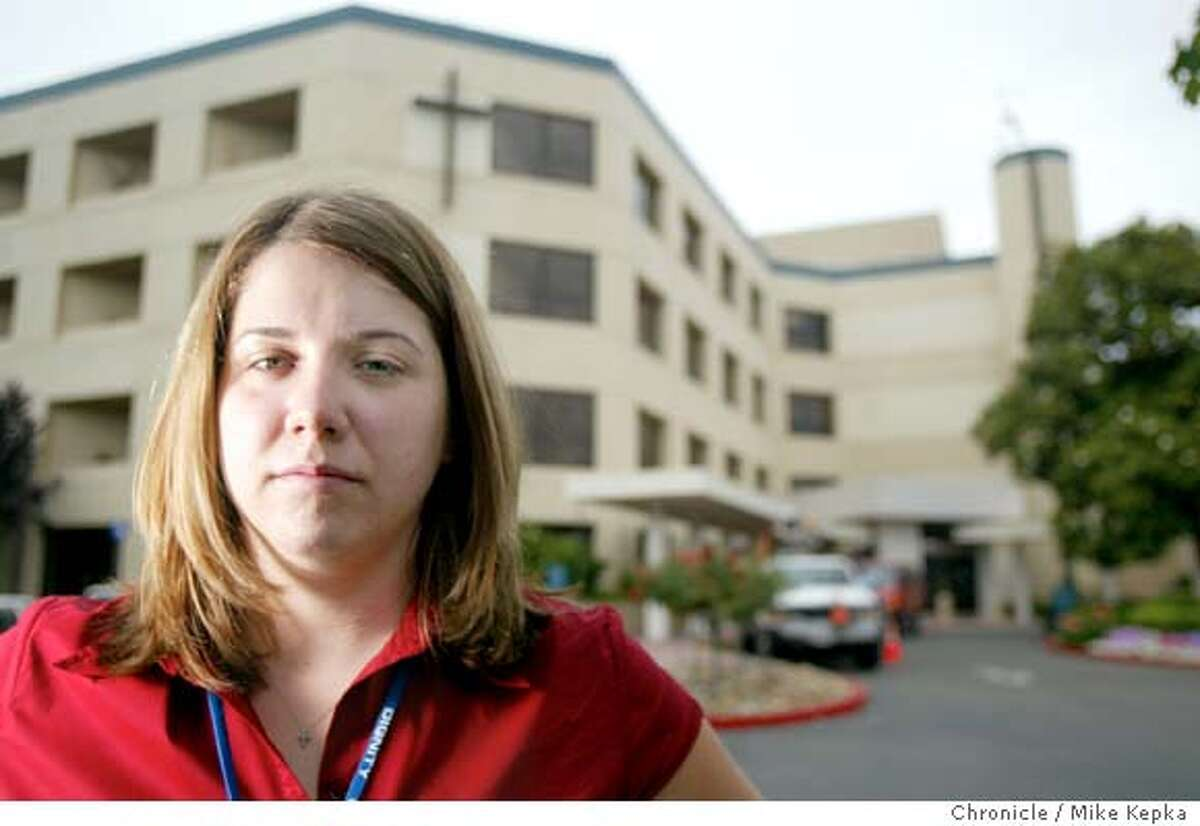 Karli Roberts (cq), 23, staffing coordinator at Santa Rosa Memorial Hospital, feels she won't be able to afford medical insurence if she were to leave her job at the hospital to pursue a career as a pastery chef. 6/10/03 in Santa Rosa. MIKE KEPKA / The San Francisco Chronicle