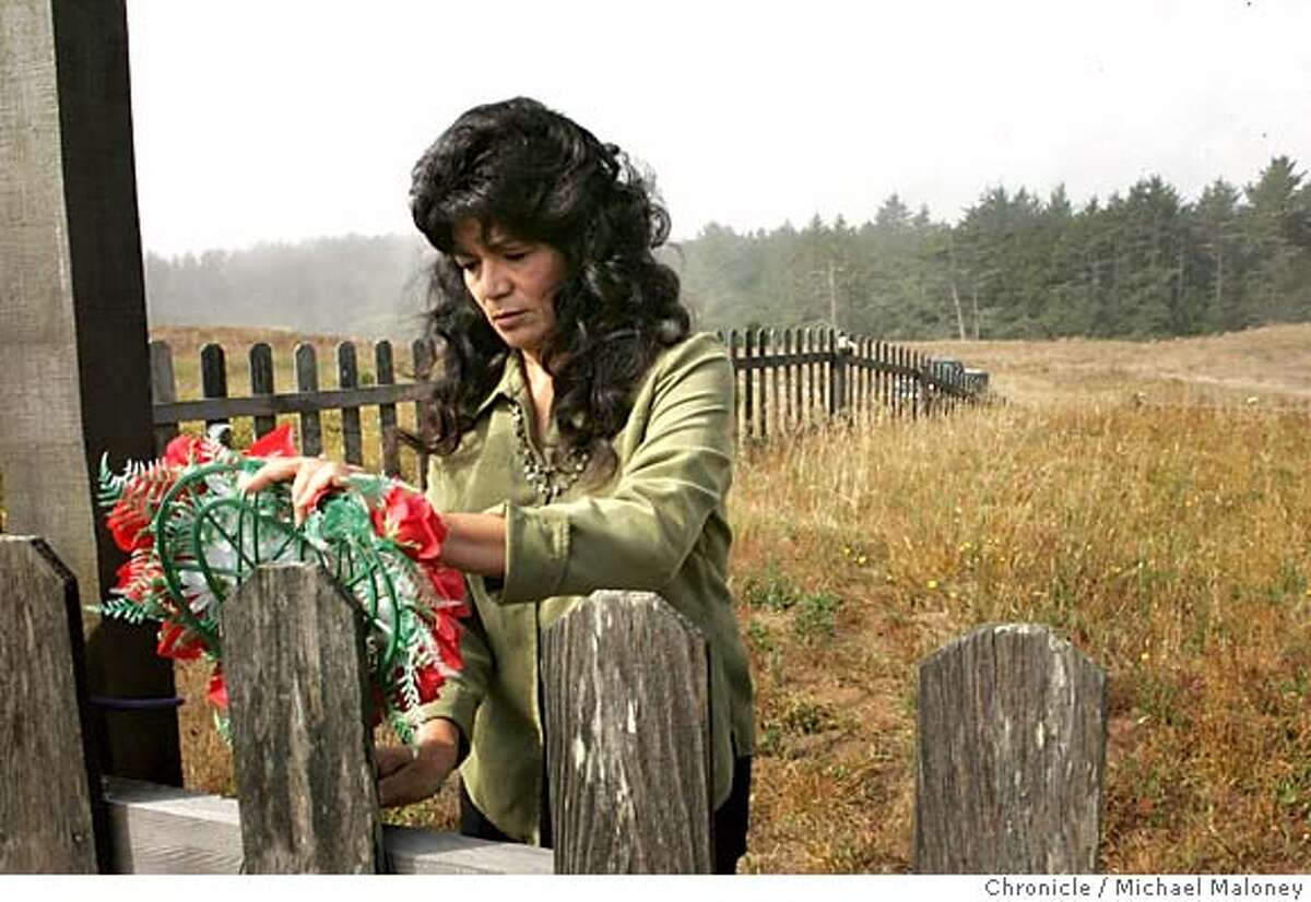 Local Tolowa tribe descendant Candace Penney replaces a fallen memorial wreath on a fence marking the burial site where her ancestors were massacred by white settlers eager to seize the land located around the mouth of the Smith River. Men, women and children were slaughtered by the hundreds. Bodies were pitched into the slough until its waters were stained red. Her grandmother, mother and aunt are all buried in hills above Yontocket Slough. The Yontocket site is now part of Tolowa Dunes State Park. Rediscovering California's North Coast. A kayak voyage by Paul McHugh, Bo Barnes and John Weed. A paddle from the Oregon border to the SF bay. Photo taken on 8/24/05 in Smith River, CA Photo by Michael Maloney / San Francisco Chronicle