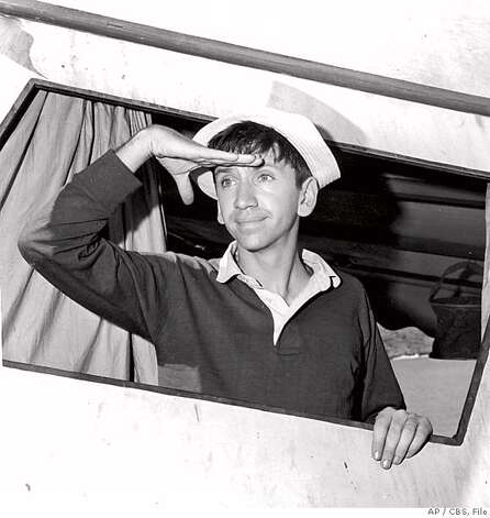 "** FILE ** In this Nov. 21, 1963 file photo released by CBS, Bob Denver, who plays the title role in the ""Gilligan's Island"" television comedy is seen. Denver died Friday, Sept. 2, 2005, at Wake Forest University Baptist Hospital in North Carolina of complications from treatment he was receiving for cancer, his agent said. He was 70. (AP Photo/CBS, File) A NOV 1963 B&W FILE PHOTO PROVIDED BY CBS . . MAGS OUT, ONLINE OUT INTERNET OUT NO ARCHIVES. NORTH AMERICA USE ONLY. ONE-TIME EDITORIAL NEWSPAPER USE ONLY. THIS IMAGE CANNOT BE ARCHIVED, SOLD, LEASED OR SHARED. THIS IMAGE CANNOT BE DISTRIBUTED Photo: Ap File"