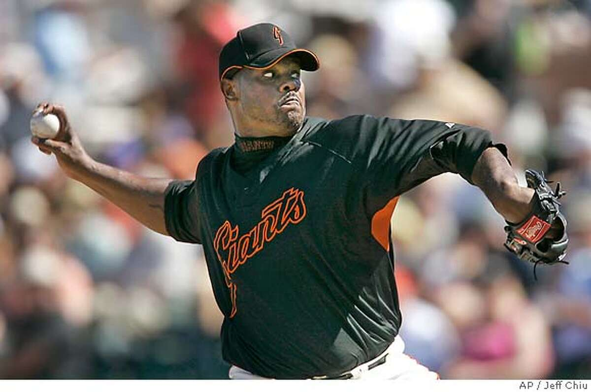 San Francisco Giants' Armando Benitez pitches to the Seattle Mariners in the fifth inning of a spring training baseball game in Scottsdale, Ariz., Sunday, March 11, 2007. (AP Photo/Jeff Chiu)