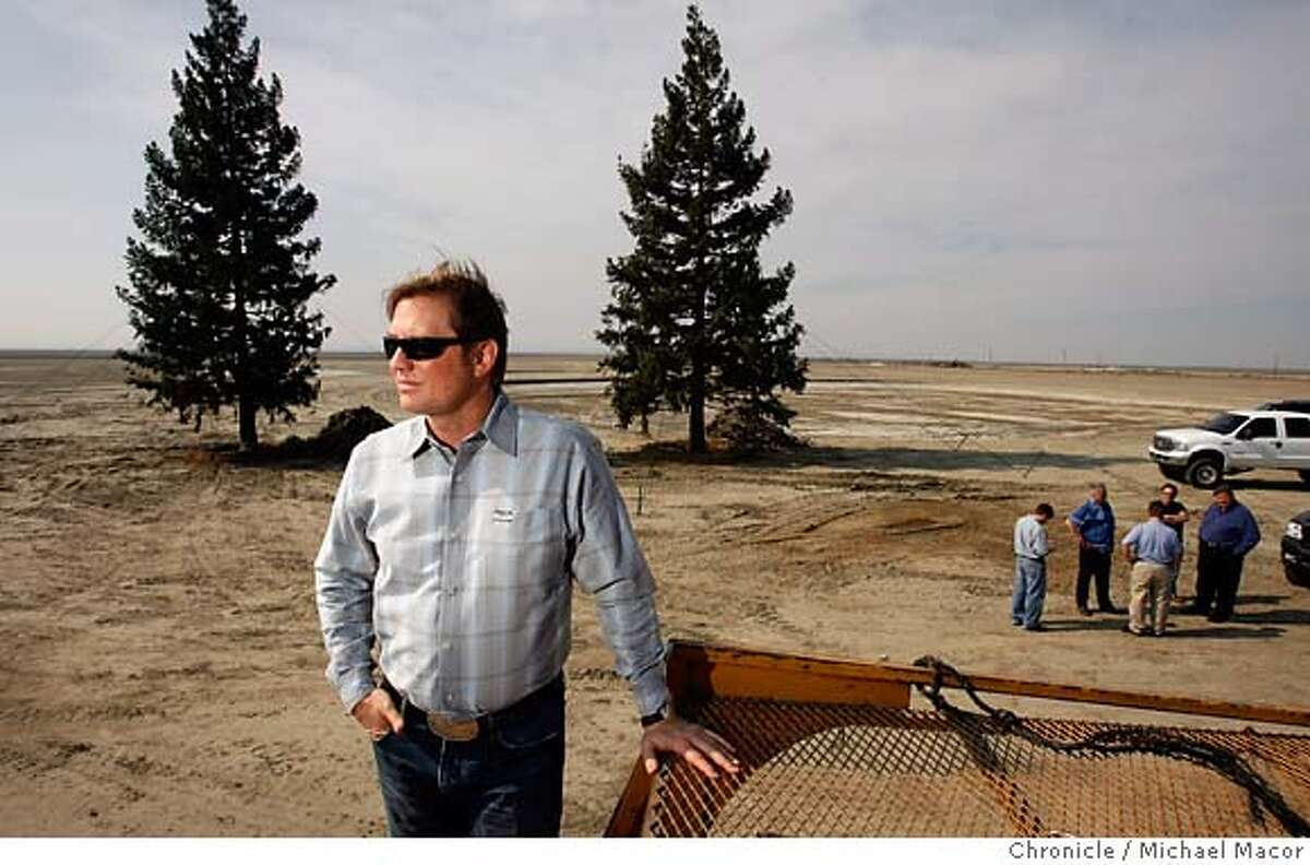 newtown_060_mac.jpg Two 50 foot tall redwood trees were moved from Visalia to the site which will be part of the visitor area, the first part of the massive project to be built. Members of his construction team in the background. Developer Quay Hays, has begun to build 50,000 new homes along with an entertainment destination, motor speedway, themed resort hotels, an auto museum, a performance driving school, as well as retail stores and other unique destination attractions. The 12,00 acres piece of prpoerty is just south of the town of Kettleman City, Ca. and straddles the Interstate 5 freeway. Photographed in, Kettleman City, Ca, on 2/16/07. Photo by: Michael Macor/ San Francisco Chronicle Mandatory credit for Photographer and San Francisco Chronicle No sales/ Magazines Out