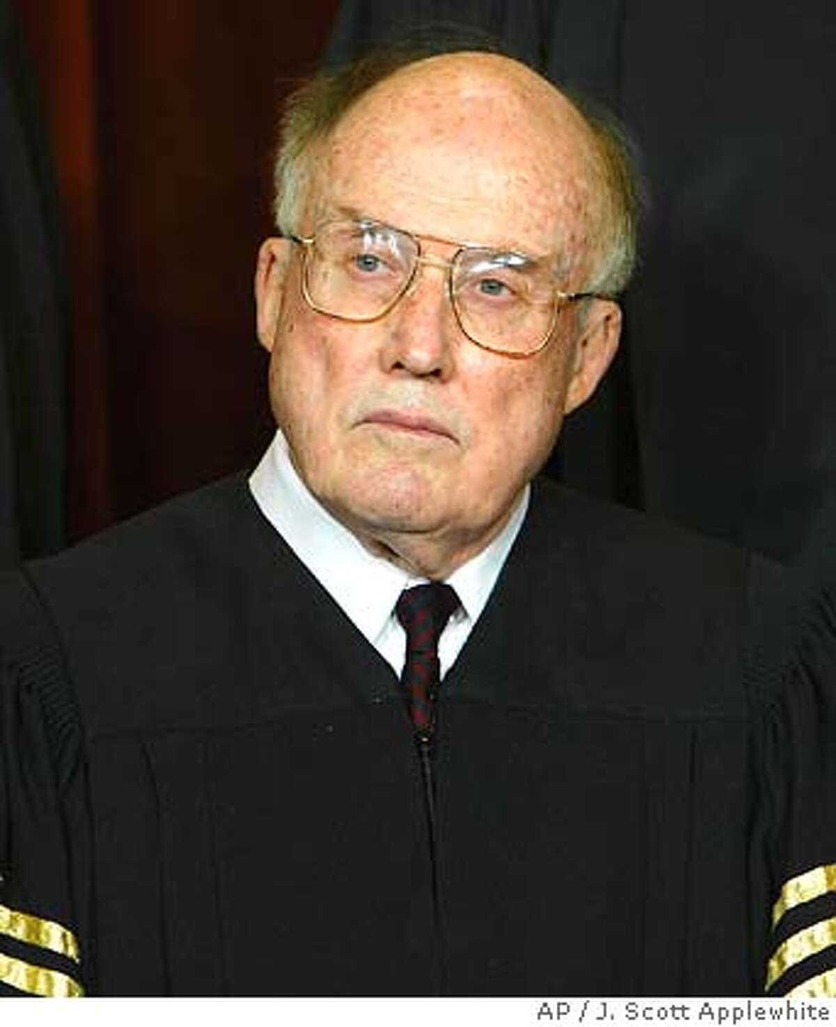 ** FILE ** Chief Justice of the United States William H. Rehnquist is seen in a file photo taken at the Supreme Court Building in Washington Dec. 05, 2003. Rehnquist has been hospitalized with thyroid cancer. (AP Photo/J. Scott Applewhite, File) Ran on: 10-26-2004 Chief Justice William Rehnquist, 80, underwent a tracheotomy over the weekend. Ran on: 10-26-2004 Chief Justice William Rehnquist, 80, underwent a tracheotomy over the weekend. Ran on: 11-14-2004 William Rehnquist, 80, was nominated by Richard Nixon and elevated by Ronald Reagan. Ran on: 11-14-2004 William Rehnquist, 80, was nominated by Richard Nixon and elevated by Ronald Reagan. DEC. 5, 2003 FILE PHOTO Ran on: 01-01-2005 William Rehnquist, chief justice, thanked those who have wished him a speedy recovery.