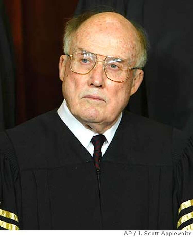 ** FILE ** Chief Justice of the United States William H. Rehnquist is seen in a file photo taken at the Supreme Court Building in Washington Dec. 05, 2003. Rehnquist has been hospitalized with thyroid cancer. (AP Photo/J. Scott Applewhite, File) Ran on: 10-26-2004  Chief Justice William Rehnquist, 80, underwent a tracheotomy over the weekend. Ran on: 10-26-2004  Chief Justice William Rehnquist, 80, underwent a tracheotomy over the weekend. Ran on: 11-14-2004  William Rehnquist, 80, was nominated by Richard Nixon and elevated by Ronald Reagan. Ran on: 11-14-2004  William Rehnquist, 80, was nominated by Richard Nixon and elevated by Ronald Reagan. DEC. 5, 2003 FILE PHOTO Ran on: 01-01-2005  William Rehnquist, chief justice, thanked those who have wished him a speedy recovery. Photo: J. SCOTT APPLEWHITE