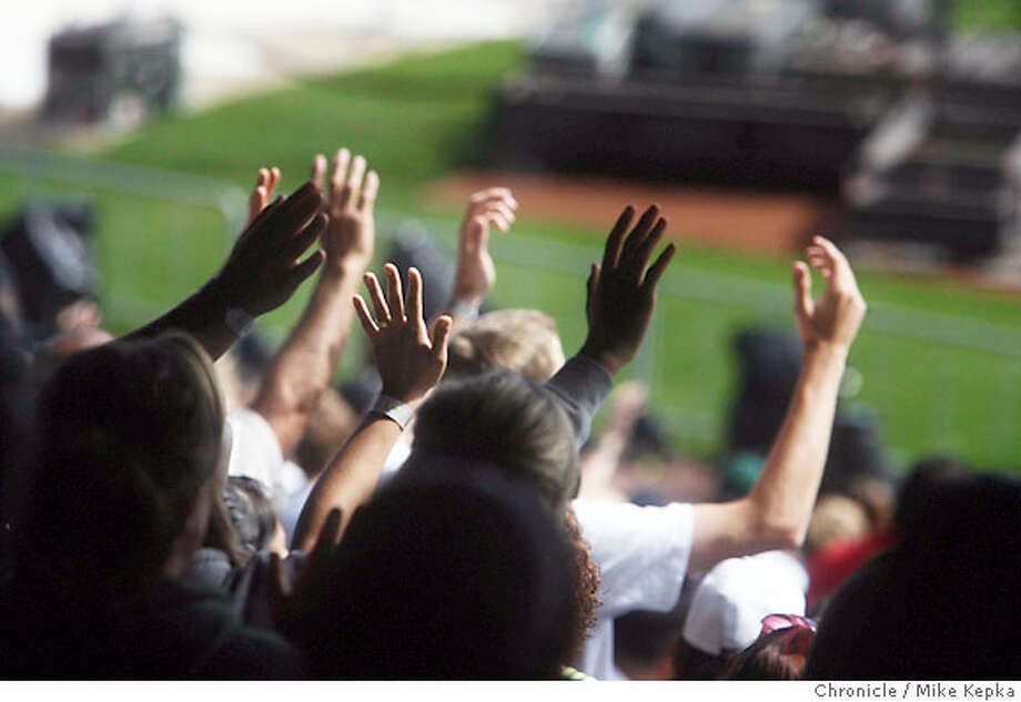 Hands of pray waive in the air at this year's BattleCry event held at AT&T park. The Evangelical Christian event is run by a youth organization called Teen Mania with an intent to inspire American youth to rise up, reject destructive pop culture messages and recreate a teen culture on their own terms. 3/10/07.  Mike Kepka / The Chronicle (cq) the source Photo: Mike Kepka