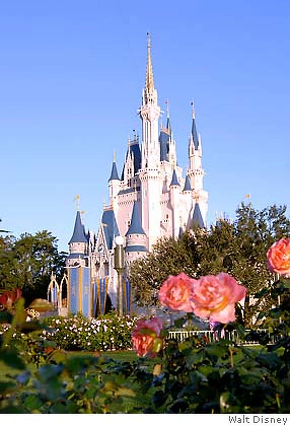 �TRAVEL DISNEY -- CASTLE SPIRES -- Colorful flowerbeds surround Cinderella Castle in the Magic Kingdom at Walt Disney World Resort. Rising 17 stories into the Florida sky, the structure serves as a landmark for park visitors and provides an entryway into Fantasyland.