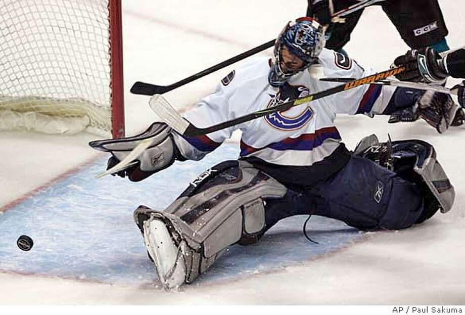 Vancouver Canucks goalie Roberto Luongo blocks a shot from a San Jose Sharks player in the first period of an NHL hockey game in San Jose, Calif., Friday, March 9, 2007. (AP Photo/Paul Sakuma) Photo: Paul Sakuma