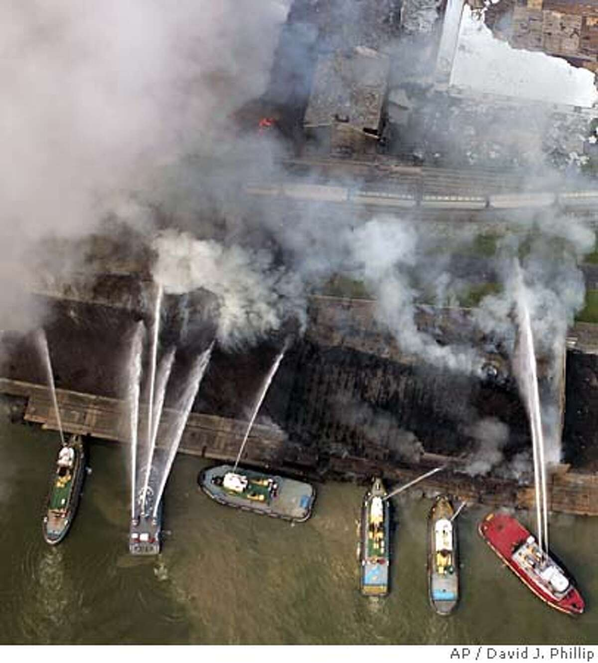 Water is sprayed on an industrial fire near downtown New Orleans Friday, Sept. 2, 2005. (AP Photo/David J. Phillip)