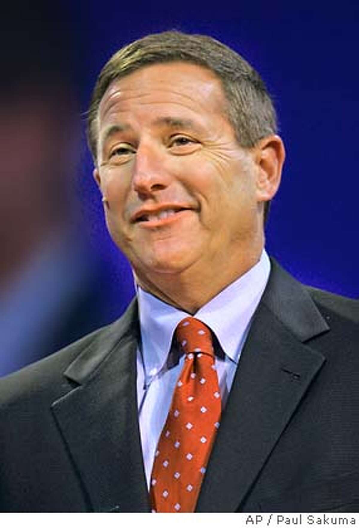 Hewlett Packard CEO Mark Hurd smiles during a keynote address at Oracle World conference in San Francisco, Tuesday, Oct. 24, 2006. Hewlett-Packard Co.'s first-quarter profit jumped 26 percent as the company benefited from higher sales of laptop computers, printers and printing supplies during a robust holiday spending season. (AP Photo/Paul Sakuma)