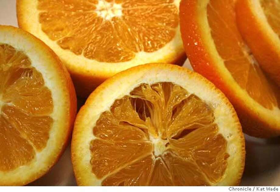 CITRUSXX_070_KW.jpg  (L to R) Freezed damaged oranges at LoBue Bros., Inc. in Lindsay where the damage to oranges during the freeze last month has caused the growing and packing industry to dramatically cut the workers hours and cut benefits such as dependent health care onTuesday February 28, 2007.  Kat Wade/The Chronicle Mandatory Credit for San Francisco Chronicle and photographer, Kat Wade, No Sales Mags out Photo: Kat Wade