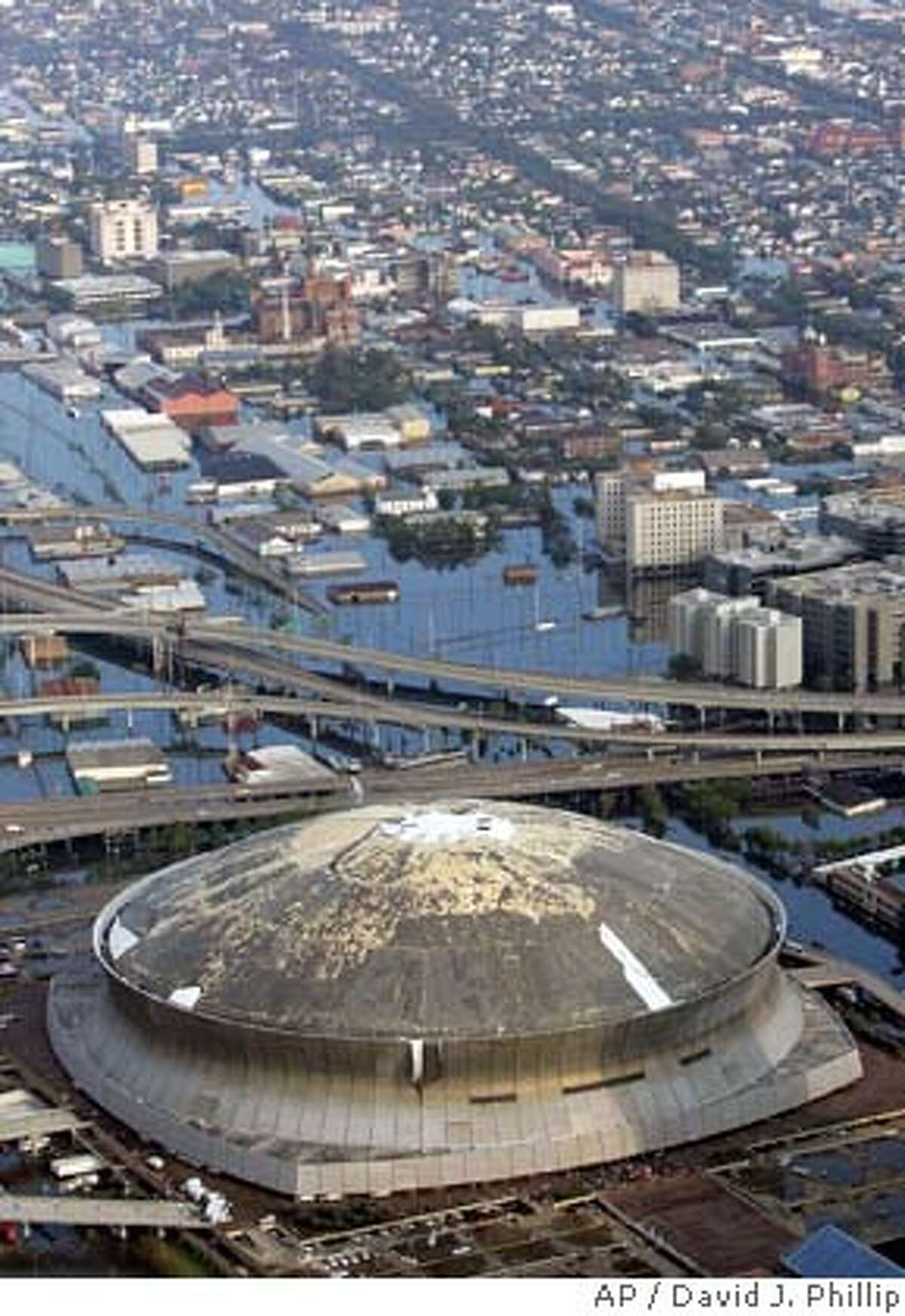 The Louisiana Superdome, which was damaged by Hurricane Katrina, sits surrounded by floodwaters Tuesday, Aug. 30, 2005 in New Orleans. (AP Photo/David J. Phillip)